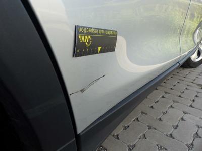 Door R R Dent(s) and scratch(es)